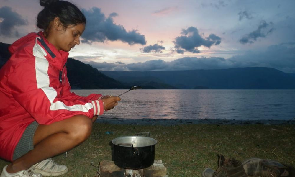 Breakfast at sunrise by Lake Toba, Sumatra