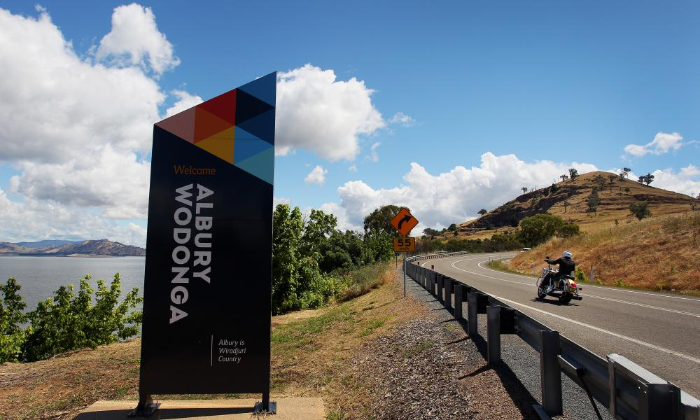 A motorbike crosses between Albury and Wodonga on the Victorian border in November 2020 when the border was open.