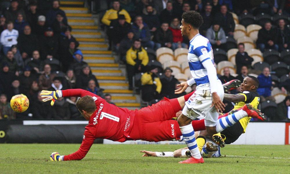 Burton Albion's Lloyd Dyer slides in to get the home side back on level pegging.