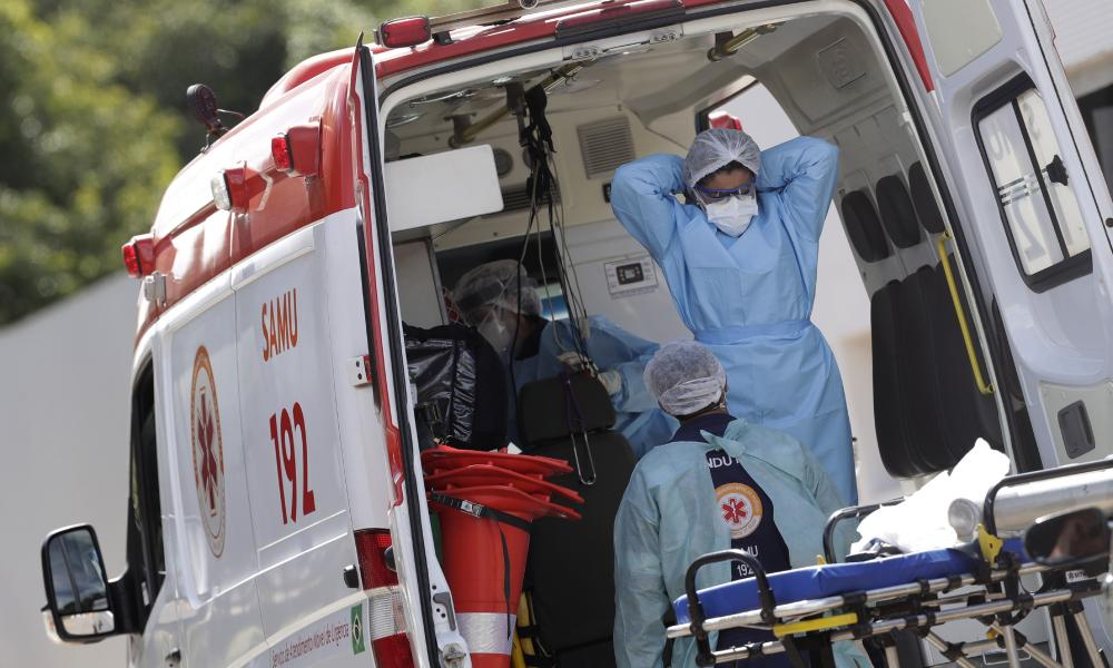 Healthcare workers prepare to take a patient suspected of having Covid into the HRAN Hospital in Brasilia, Brazil, Wednesday, 3 March 2021.