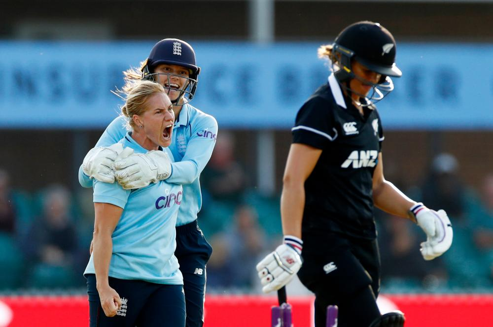 England's Katherine Brunt celebrates with Amy Jones after taking the wicket of New Zealand's Suzie Bates.