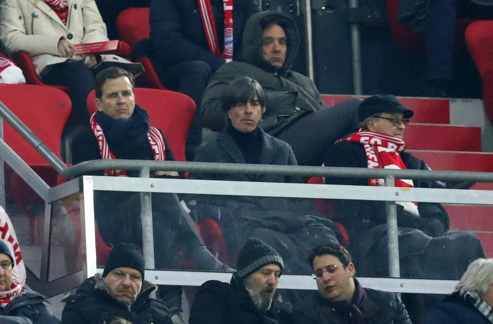 Germany head coach Joachim Low and Germany manager Oliver Bierhoff watch the match.