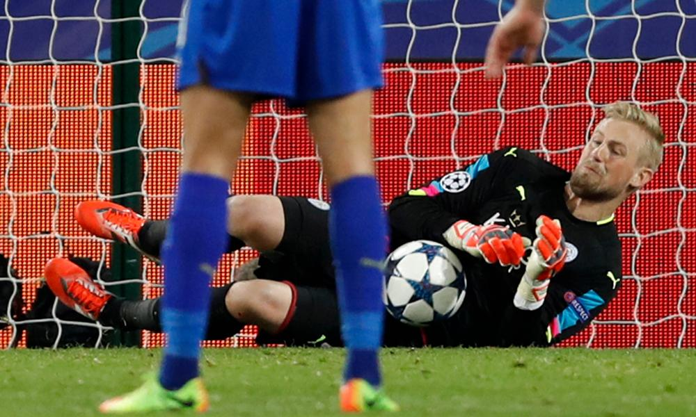 Leicester keeper Kasper Schmeichel saves Steven N'Zonzi's terrible penalty.