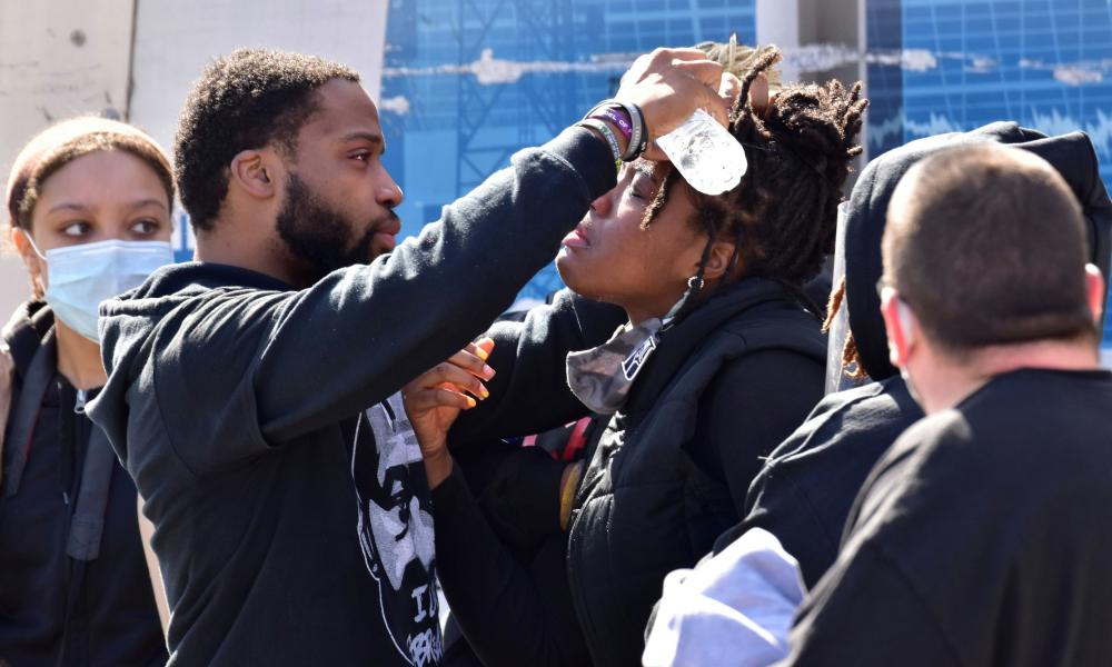 A woman's eyes are washed from pepper spray deployed by police at a Get Out The Vote march in Graham, North Carolina.