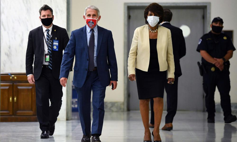 Anthony Fauci, director of the National Institute for Allergy and Infectious Diseases, and Maxine Waters, Democratic congresswoman, arrive for the House Select Subcommittee on the Coronavirus Crisis hearing in Washington today.