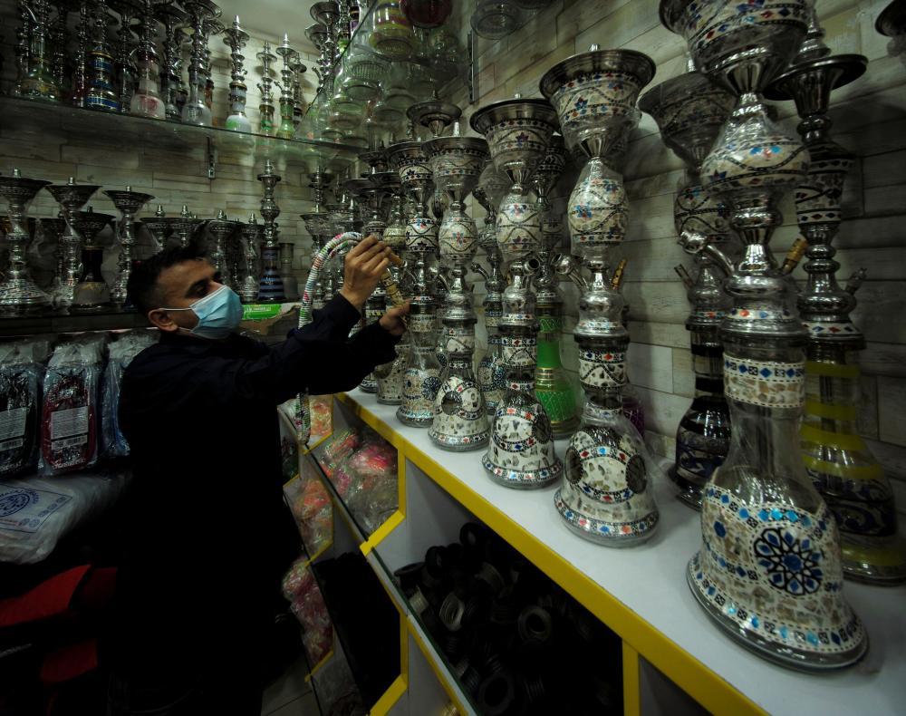 A salesman at his tobacco and shisha shop, following the outbreak of the coronavirus in Manama, Bahrain.