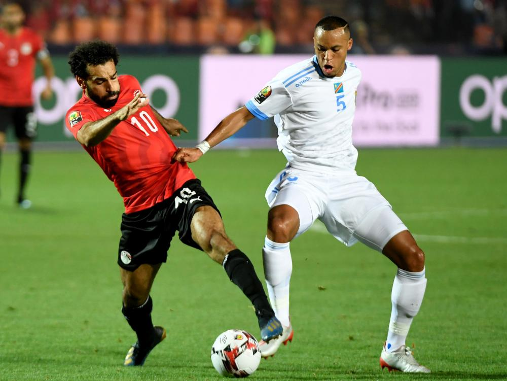 Egypt's forward Mo Salah (left) tussles with Congo's defender Marcel Tisserand.