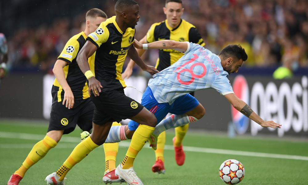 Bruno Fernandes of Manchester United is challenged by Christopher Martins Pereira of Young Boys.