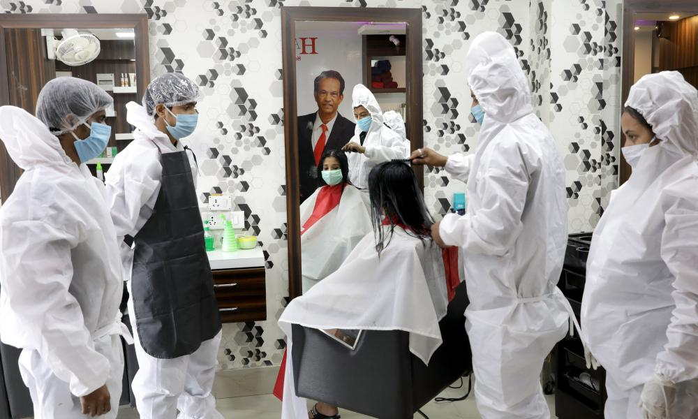 Hairdressers in PPE in Kolkata, India