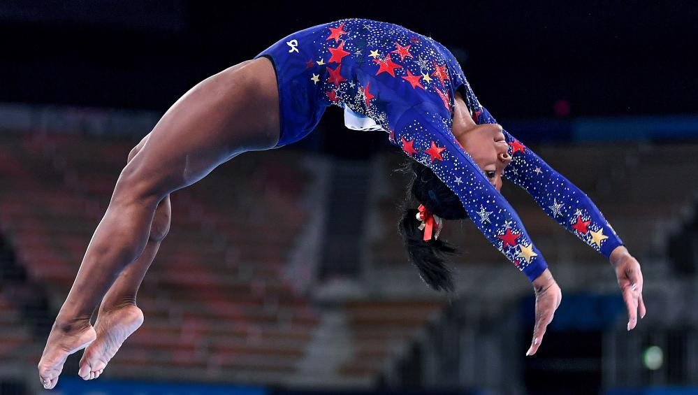 USA's Simone Biles competes on the beam in the women's team qualifying at the 2020 Tokyo Olympics, July 24 2021