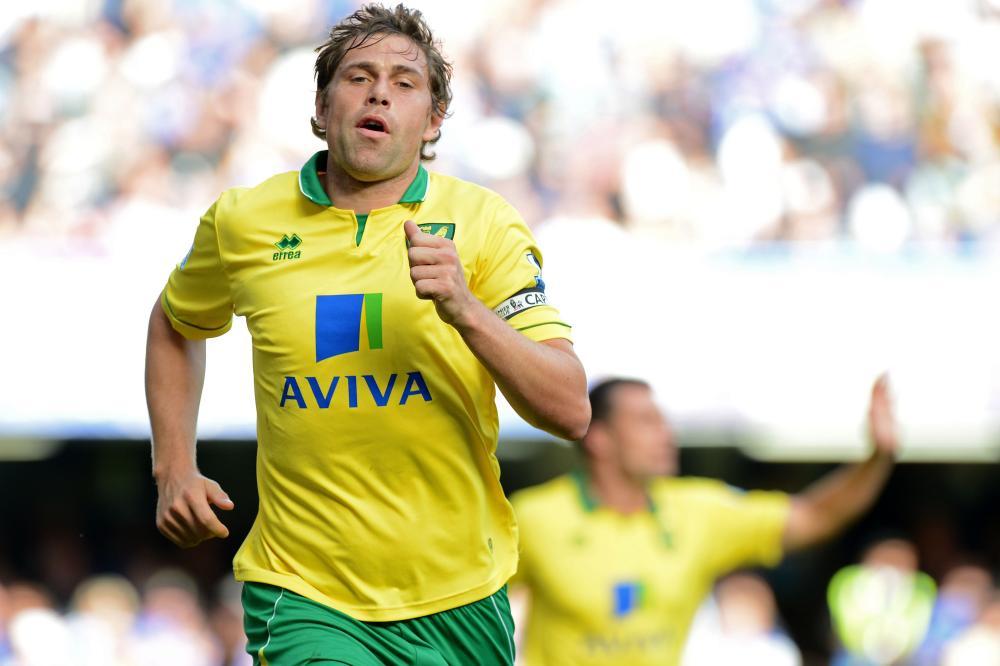 Grant Holt celebrates after scoring against Chelsea at Stamford Bridge in 2012.