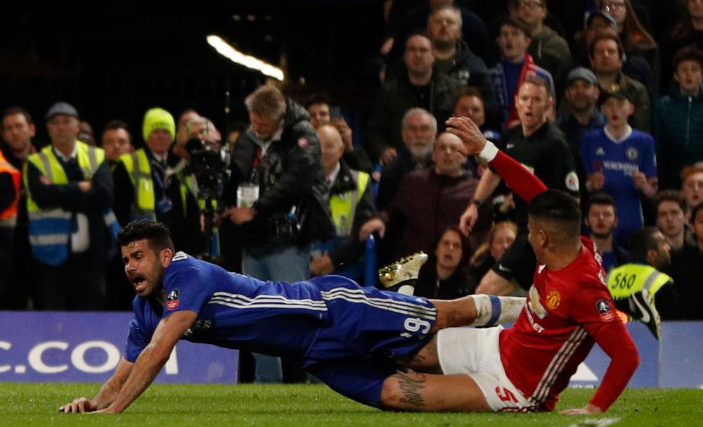 Rojo tackles Diego Costa.