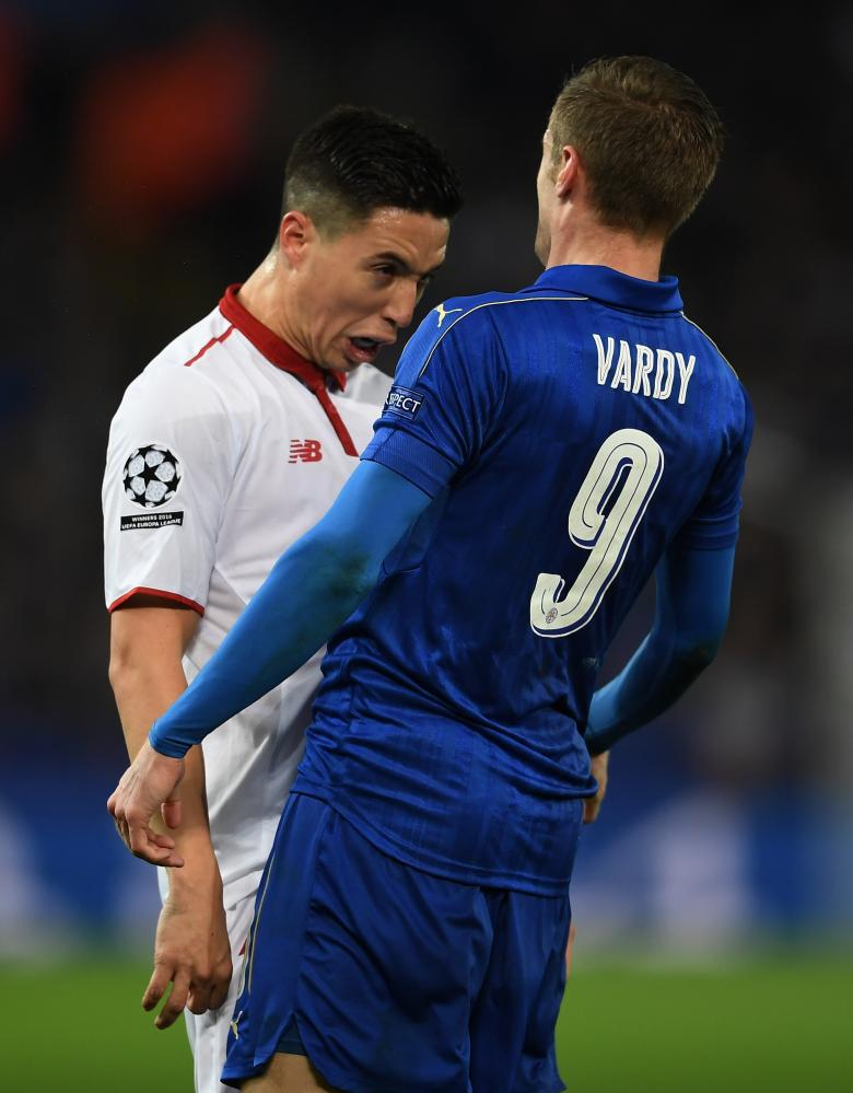 Samir Nasri of Sevilla and Jamie Vardy of Leicester City butt heads.