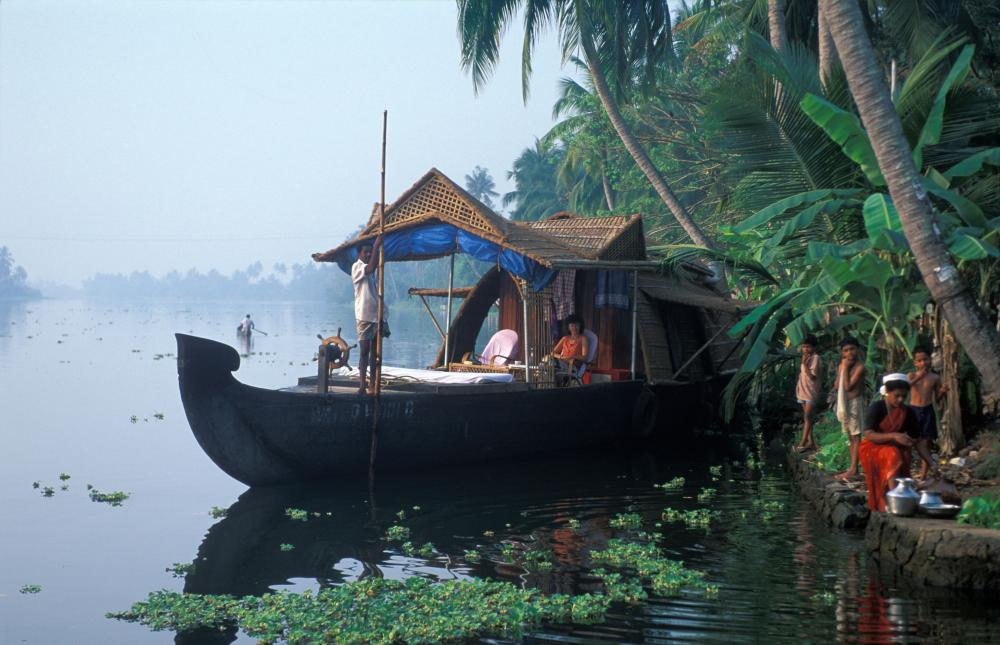 A houseboat in the backwaters of Kerala, prior to the Covid-19 pandemic ...