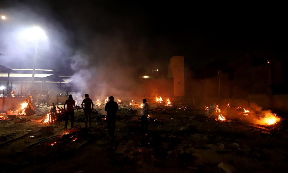 Fires from funeral pyres can be seen at night in New Delhi