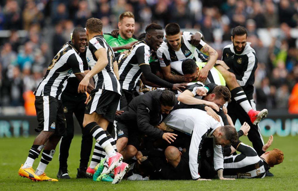 Newcastle players celebrate winning the league.