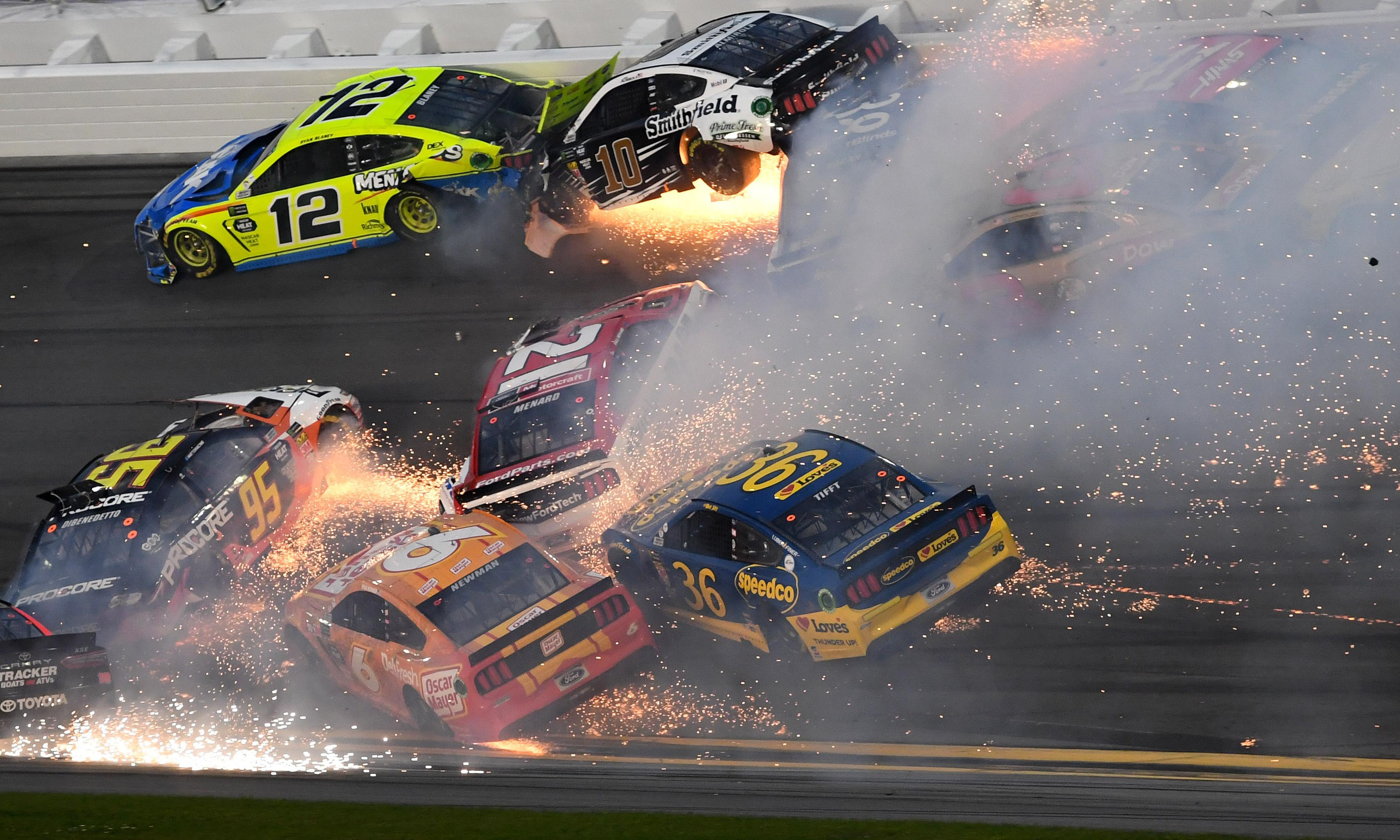 Denny Hamlin wins Daytona 500 after series of huge crashes