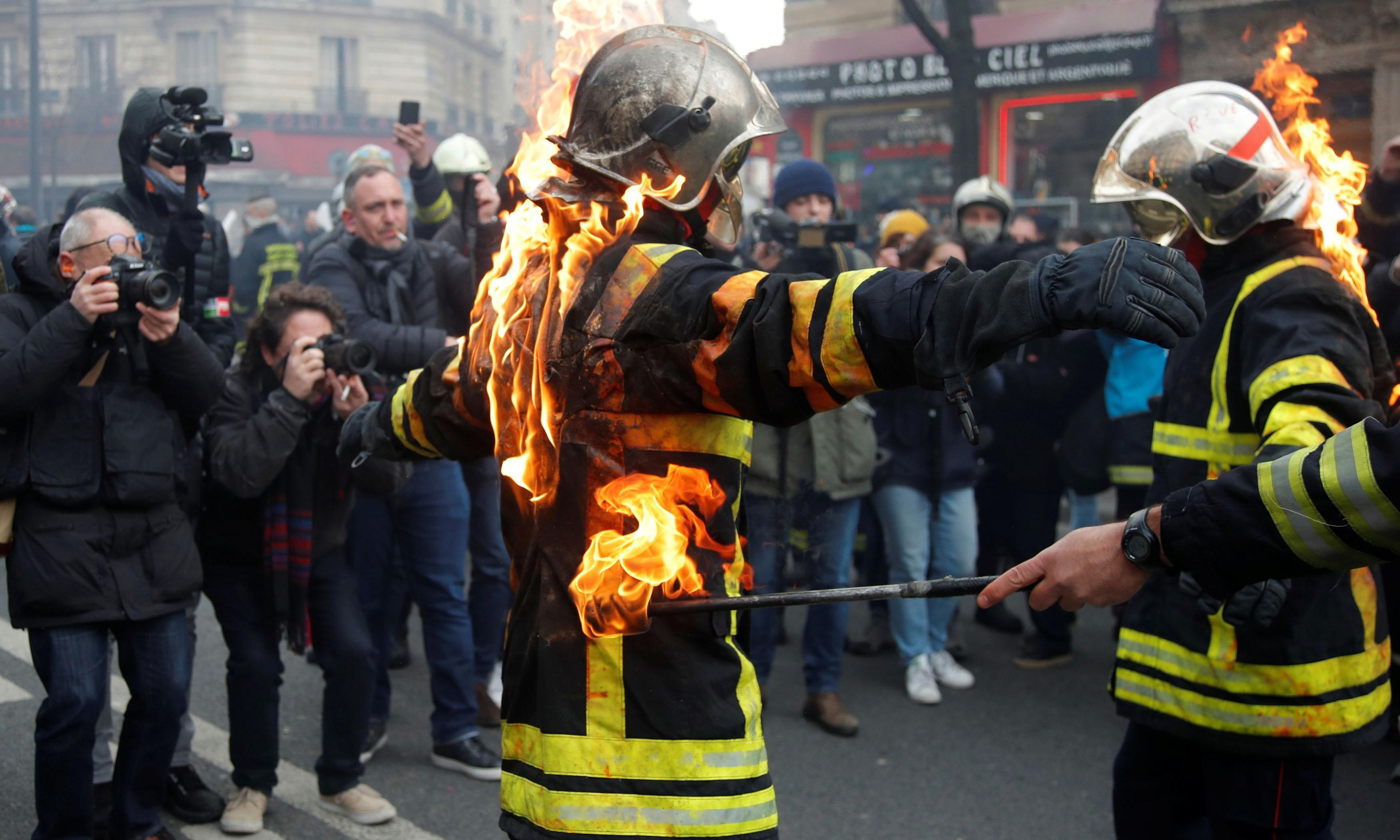 French police clash with firefighters during Paris protest