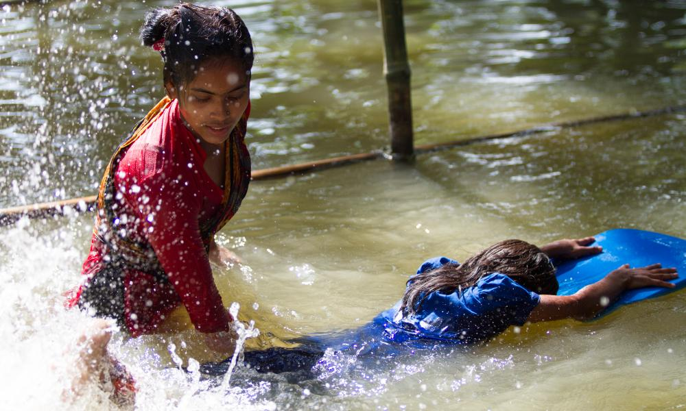 A child being taught to swim