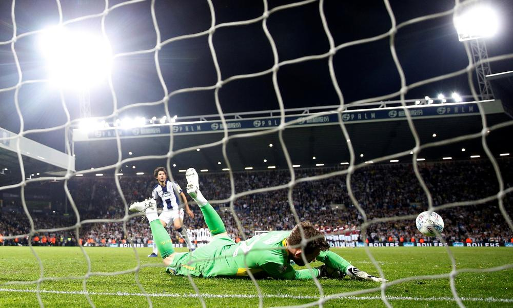 Aston Villa's Jed Steer saves a penalty from West Bromwich Albion's Ahmed Hegazi.