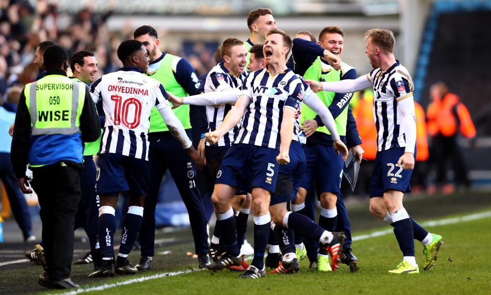 Tony Craig, centre, celebrates with his teammates after FA Cup fifth round victory over the reigning Premier League champions, Leicester City.