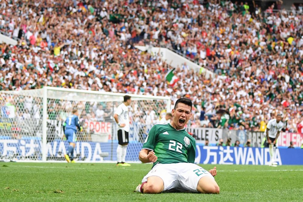 Hirving Lozano celebrates after scoring the winner against Germany.