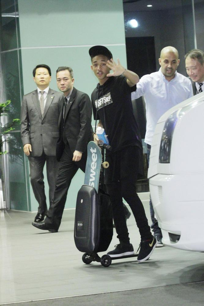 Jaden Smith leaves a Taiwan airport on a scooter.