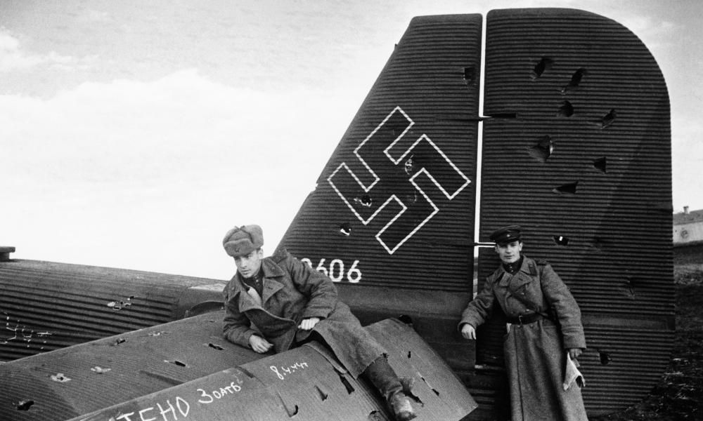 Soviet soldiers on a seized Nazi plane.