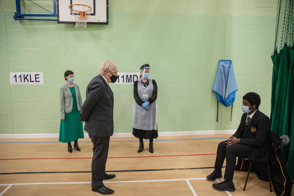 Boris Johnson visiting the school gym being used as a makeshift testing centre for the students at Sedgehill School in Lewisham, London, this morning.