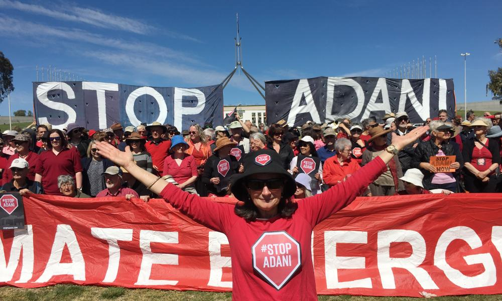 Protesters in front of Parliament House, Canberra, on 7 October during a national day of action against Adani.