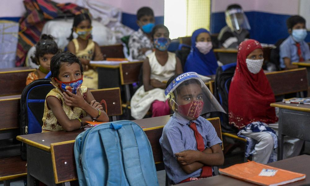Students attend a class at a government school in Hyderabad on 1 September