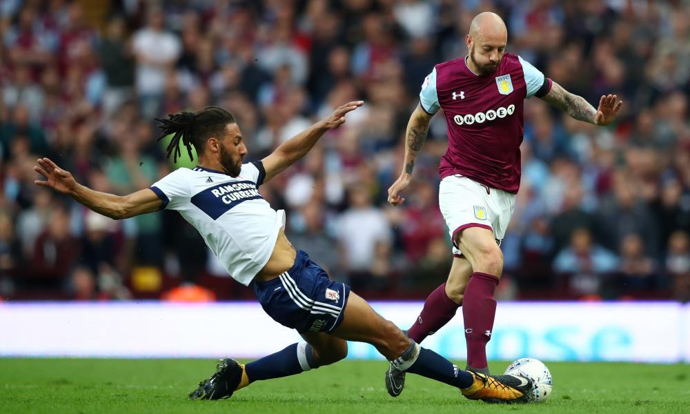 Alan Hutton of Aston Villa attempts to skip past the challenge of Boro's Ryan Shotton