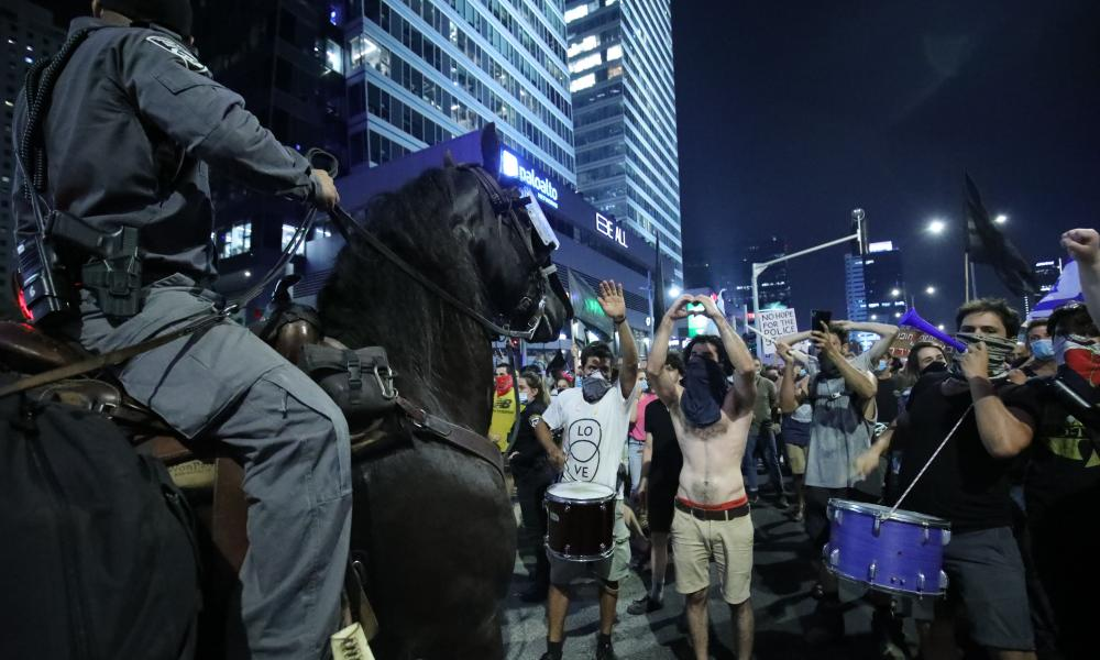 Mounted Israeli forces block the road as people stage a protest against Israeli prime minister Benjamin Netanyahu, demanding his resignation over corruption cases and a deterioration in economic conditions.