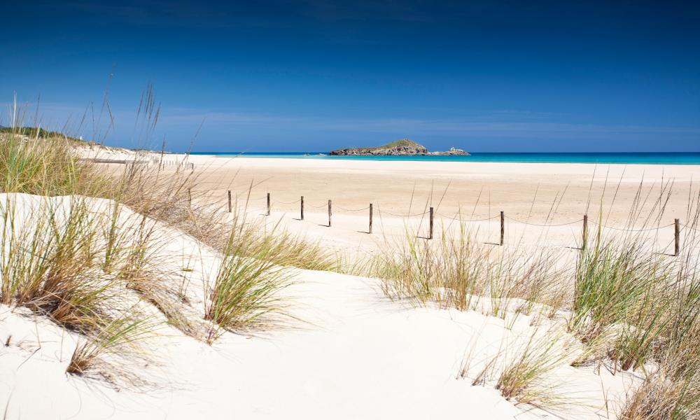 The wide soft sands of huge Su Giudeu beach in the south of Sardinia.