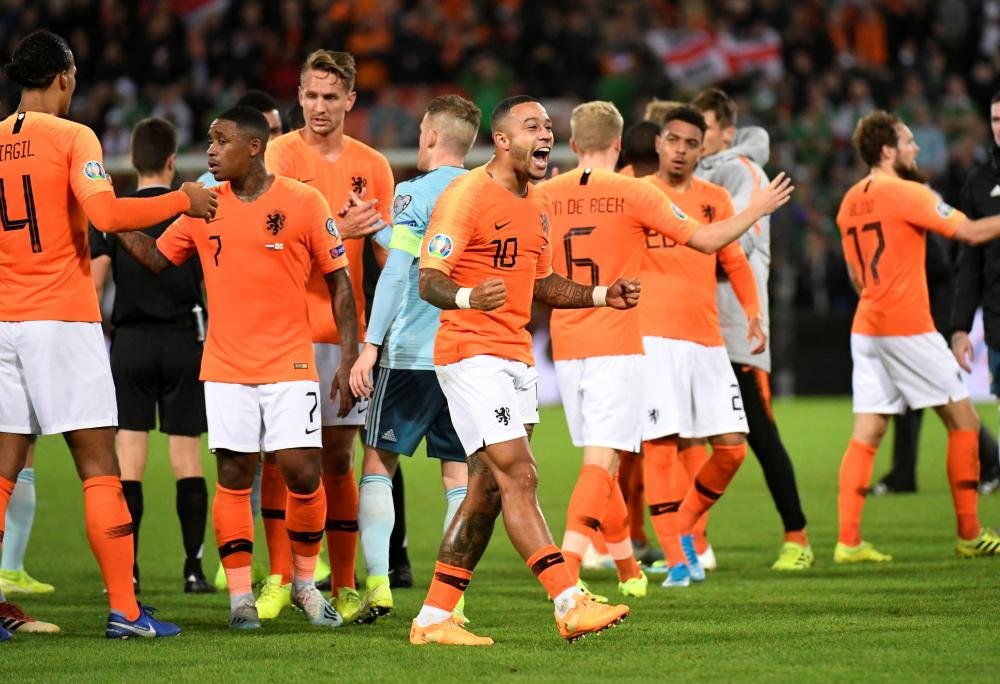 Netherlands' Depay celebrates after their 2-1 win over Northern Ireland.