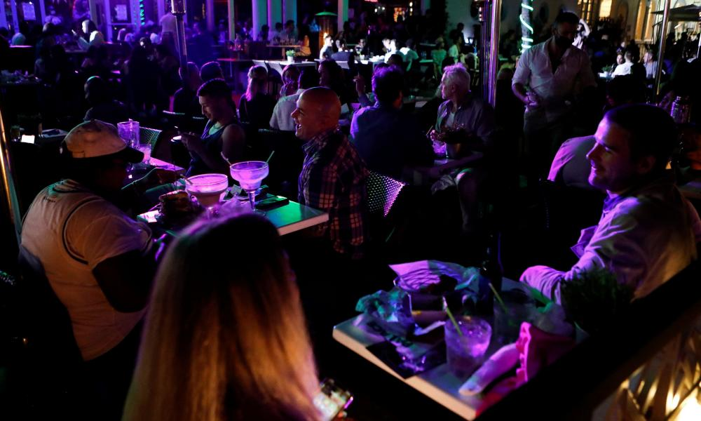 People gather at a bar during spring break festivities in Miami Beach.