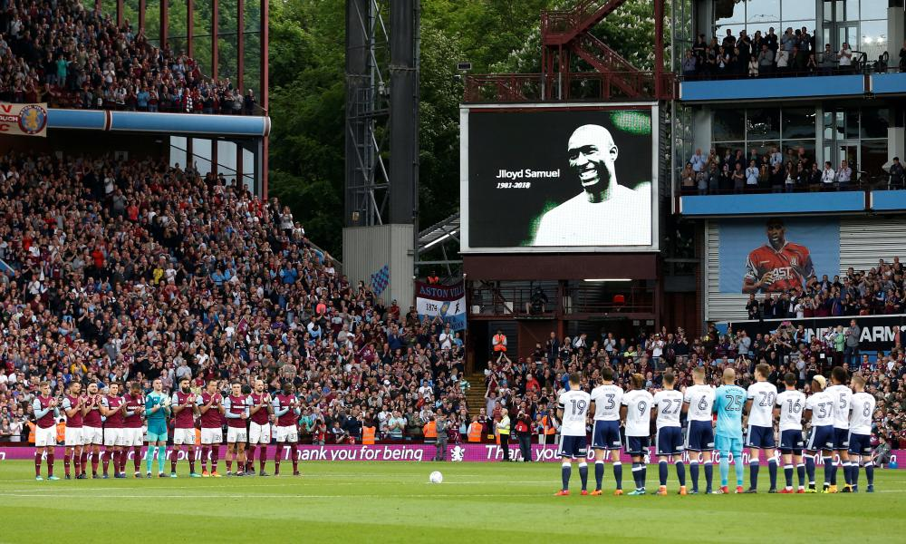 Everyone pays their respect during the minute's applause in memory of Jlloyd Samuel.
