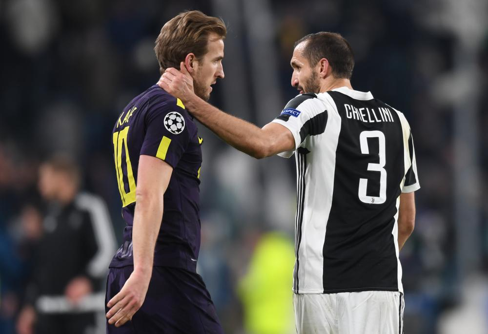 Harry Kane and Giorgio Chiellini embrace after the match.