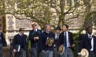AYYFHH Schoolboys after lessons by the school chapel Harrow School Harrow on the Hill Middlesex United Kingdom