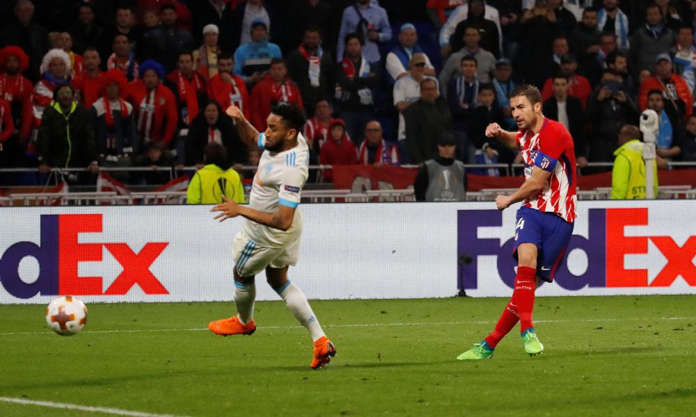 Atletico Madrid's Gabi scores their third goal