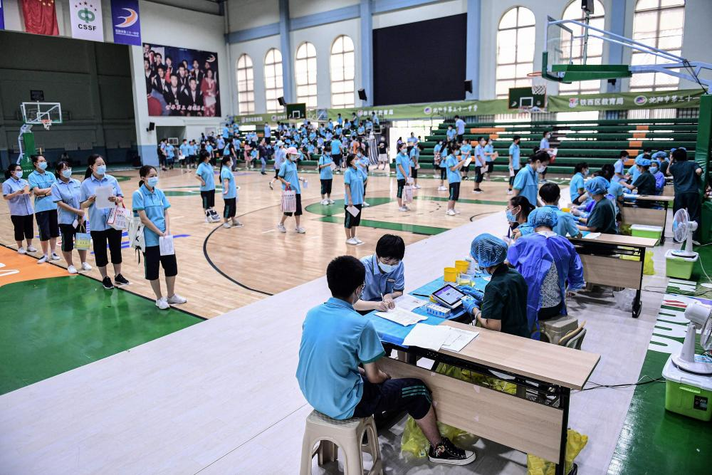 Students queue to receive Covid-19 vaccines at a high school in Shenyang, Liaoning province, China.