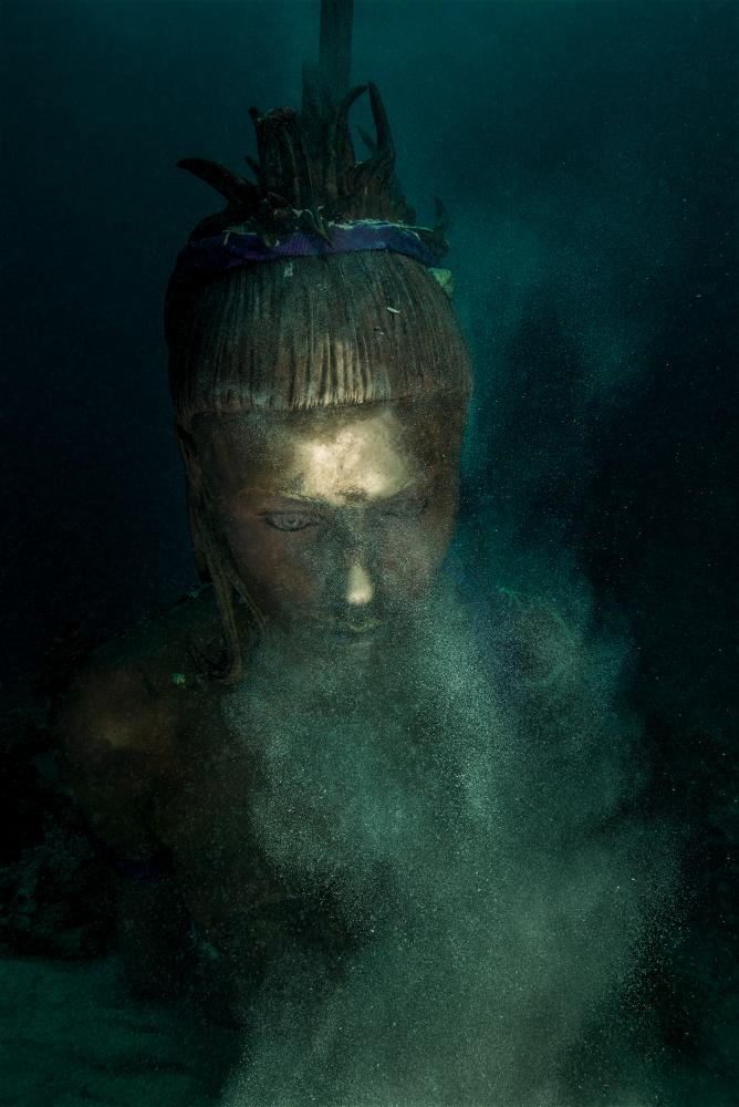 A golden figure looms from the deep – is this a new Hirst statue?
