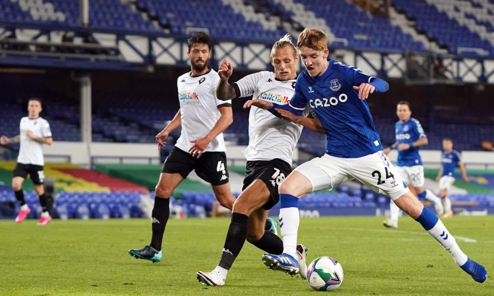 Everton's Anthony Gordon attempts to go past Salford City's Oscar Threlkeld.