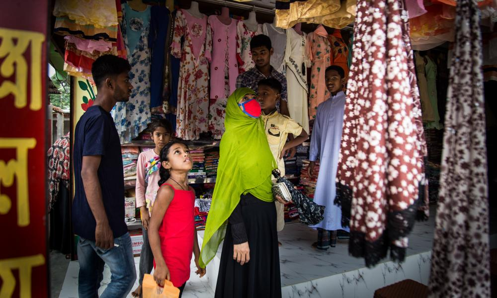 Tasnia and her daughter shopping in the village market before Eid.