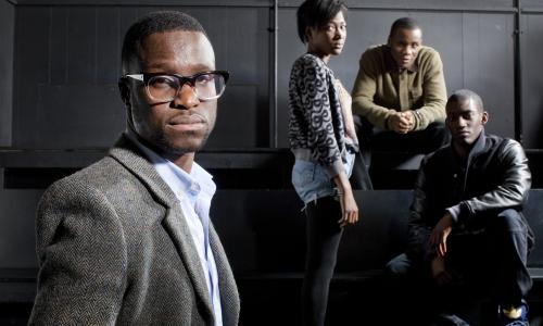 Femi Oguns (left), the founder and CEO of the Identity Drama School in Hackney with three of his star pupils (left to right) Adelayo Adedayo, Tobi Bakare and Malachi Kirby  Hackney London By David Levene 23/2/12