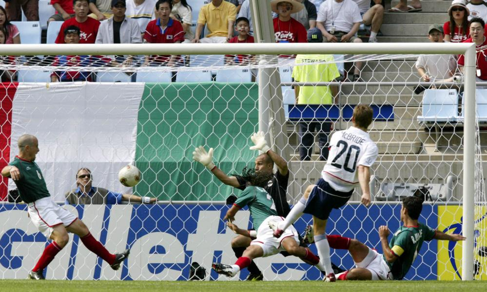 Brian McBride scores the opener against Mexico