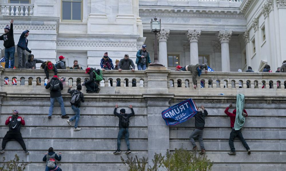 File: Rioters climb the west wall of the the U.S. Capitol in Washington during the insurrection by extremist supporters of Donald Trump on January 6, 2021.
