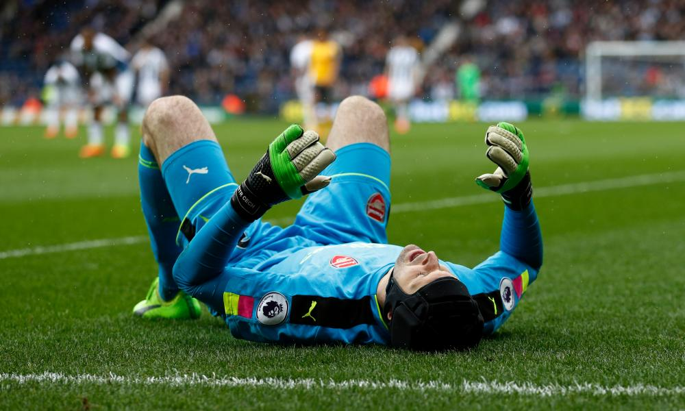 Arsenal's Petr Cech looks to be in a bit of pain.