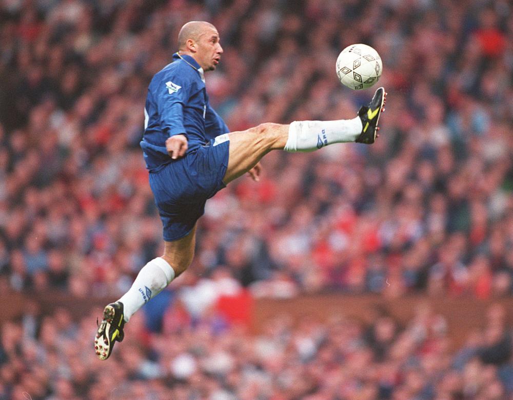 Gianluca Vialli flies through the air before scoring against Manchester United.