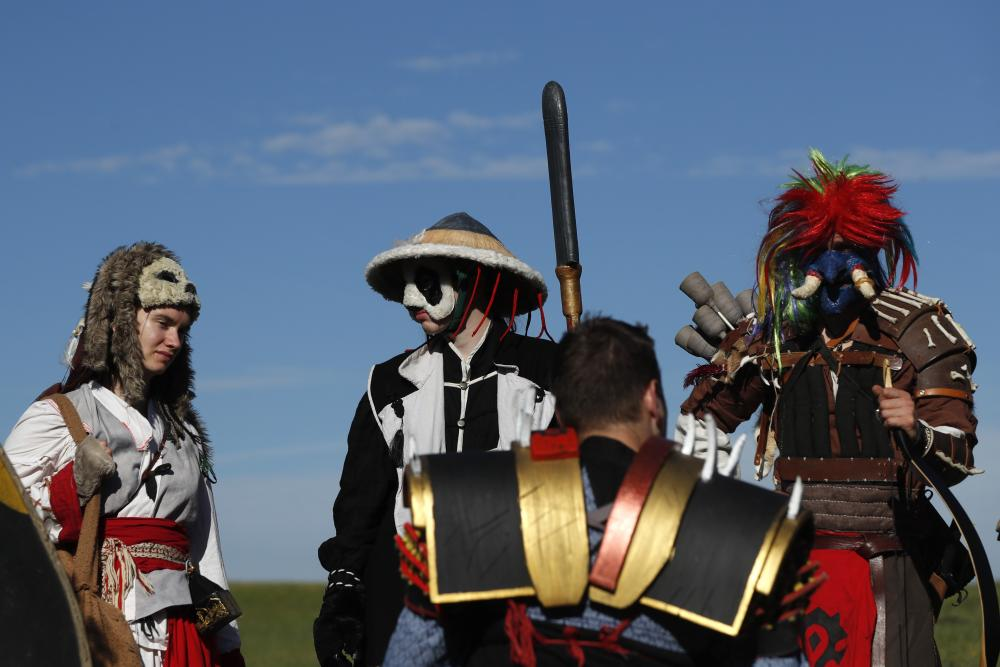 Enthusiasts dressed as characters from the computer game World of Warcraft stand on a meadow during a festival near the town of Kamyk nad Vltavou, Czech Republic, on Saturday 5 September 2020.